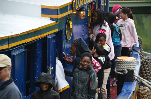 Fourth-graders from School No. 2 in Rochester visit the Urger, a historic tugboat, on Oct. 7, 2015 when the vessel was in Holley.