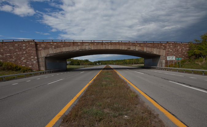 Provided photo by Landmark Society of WNY – Credit Richard Margolis: The Lake Ontario State Parkway runs near the lakeshore in Orleans and Monroe counties and has been in need of paving and repair in recent years.
