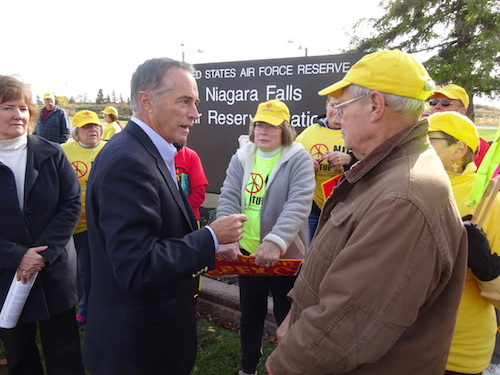 Provided photo from Save Ontario Shores: Congressman Chris Collins, R-Clarence, talks to Save Ontario Shores supporters outside the Niagara Falls Air Reserve Station on Monday.