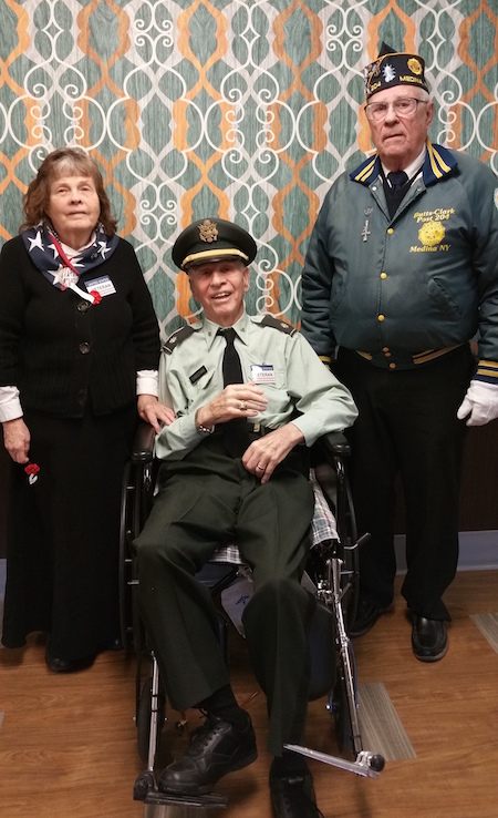 Visiting veteran Frank Berger, back right, is shown with resident Henry Christian proudly wearing his Army uniform. He was accompanied by his wife Victoria, who served in the Air Force. Members of their church family from Old Paths Bible Baptist Church in Clarendon were also present.