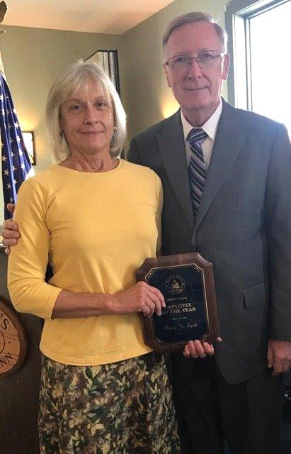 Provided photo: Mary Jo Syck is pictured with David Callard, chairman of the Orleans County Legislature, after she was named the county's employee of the year during a luncheon last Thursday at Tillman's Village Inn.
