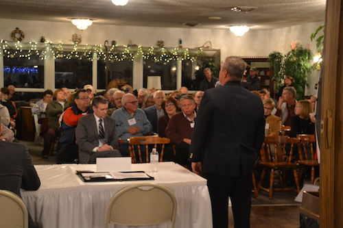 Photos by Tom Rivers: Kevin Bush, regional director for the state Department of Transportation, addresses more than 100 people at a meeting Monday evening on future paving plans for the Lake Ontario State Parkway. The meeting with State Sen. Robert Ortt and Bush was organized by the Oak Orchard Neighborhood Association. They met in the home of Gene Haines, which is located near the Parkway by Lake Ontario.