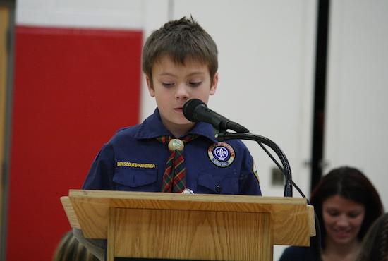 Fourth grader Zachary Mrzywka gives a presentation during the Veterans Day assembly.