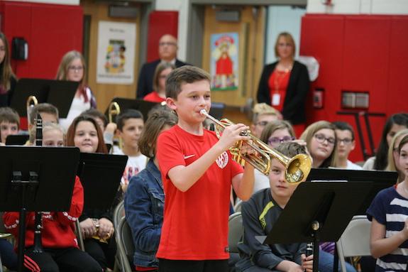 "Sixth grader Chris Lyndaker plays ""Taps."""