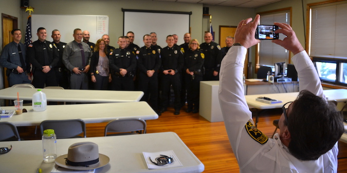 Orleans County Sheriff Randy Bower takes a photo of the group of 18 officers who earned certificates of completion for a 40-hour class about responding to people having a mental health crisis.