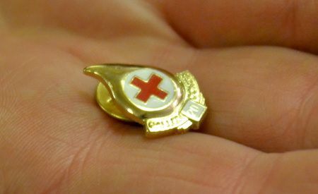 Miller holds a pin noting he was a 20-gallon blood donor.