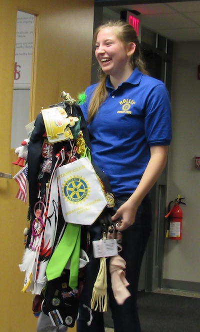 Claudia Dreschel holds her Rotary jacket completely covered in mementos from her exchange trip to Austria.
