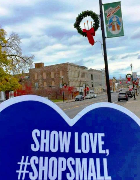 """Photo by Kim Pritt: This photo shows downtown Albion with a promotional display about """"Shopping Small"""" and supporting local small businesses."""