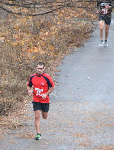 Photos by Tom Rivers: Jose Quiros of Medina runs along the towpath in today's 5-kilometer race in medina where he finished second in 19:55. This was the 201st race he's run this year.