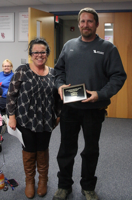 Provided photo: Robin Silvis, a member of the Holley Board of Education, is pictured with John Sherman at last week BOE meeting in Holley.
