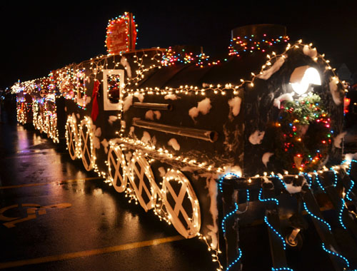 """Photo by Tom Rivers: Matt C.M. Contracting was grand champion in the Parade of Lightslast year.Matt Mundion, owner of Matt C.M. Contracting, created the """"Medina Express,"""" a train with four units."""