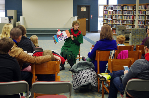 File photo: Catherine Cooper is dressed as an elf while reading a children's story during the Olde Tyme Christmas celebration in 2014. Cooper will serve as grand marshal of the Parade of Lights on Nov. 26.