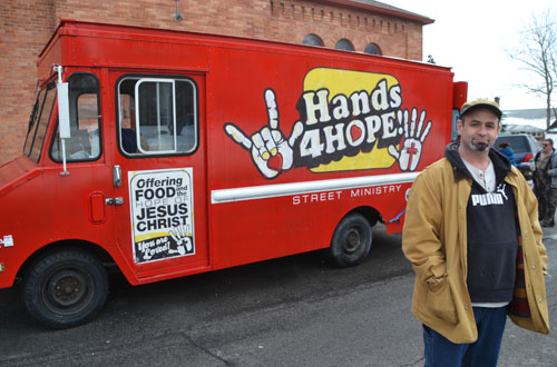 "Jack Burris is pictured with the Hands 4 Hope vehicle, ""Clifford,"" which goes out four Saturdays each month."