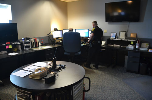 Kevin Colonna, an Orleans County deputy sheriff, looks for information from dispatcher Bill Oliver in this photo from April 2015.