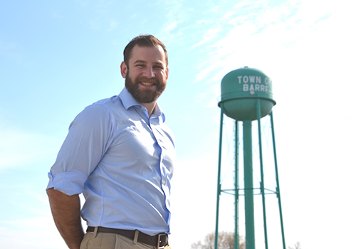 Photo by Tom Rivers – Ben Yazman, Heritage Wind project developer, is pictured by the Barre water tower on Route 98 behind the firehall in this photo in early May.