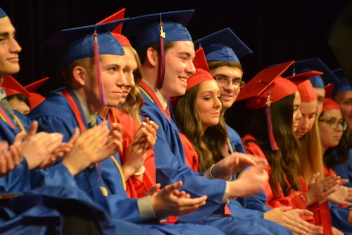 Photo by Tom Rivers: Some members of the Class of 2016 smile during commencement last June.