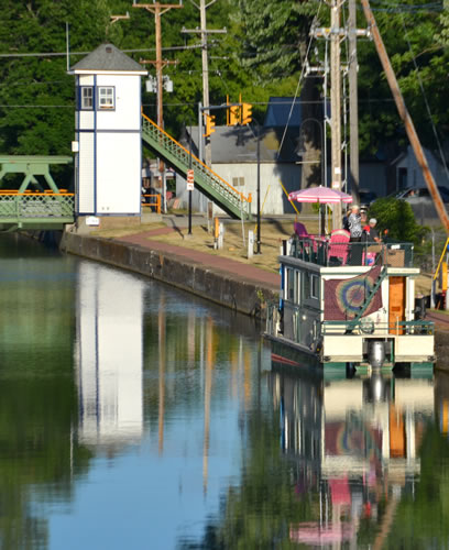Photo by Tom Rivers: The Traveling Towpath Troubadours play from a house boat on the Erie Canal in Albion on July 10. They will be back in Albion again next year on July 9.