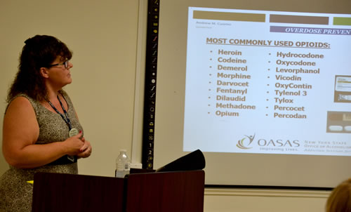 "Photos by Tom Rivers: Sherri Bensley, assistant director of prevention for GCASA, discusses commonly used opioids during a presentation on July 13. She said addicts get the drugs often from friends or relatives, ""not the street corner drug dealer."""