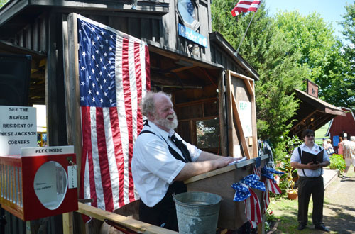 "Erik Olsen leads a town meeting at West Jackson Corners during a recent ""Old Tyme Day."""