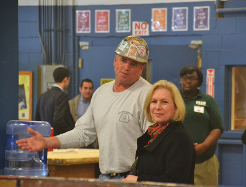 File photo by Tom Rivers: U.S. Sen. Kirsten Gillibrand is pictured on Oct. 27, 2014 visiting the Iroquois Job Corps in Medina. She is shown touring the carpentry shop with Michael Wisor, a carpentry instructor.