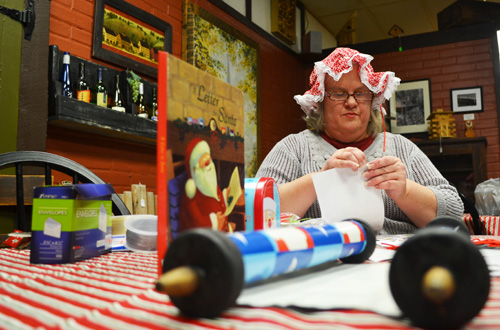 File photo by Tom Rivers: Mrs. Claus is pictured here during Hometown Holiday in December 2013. She will be back at Knight's Pride today from noon to 3 p.m.