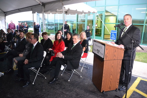 Robert Chapman, Pride Pak's vice president of sales and marketing, welcomes about 300 people to the ribbon-cutting and opening celebration for the company's new facility in Medina. Chapman credited CEO Steve Karr, lower left, with pushing the project to completion.