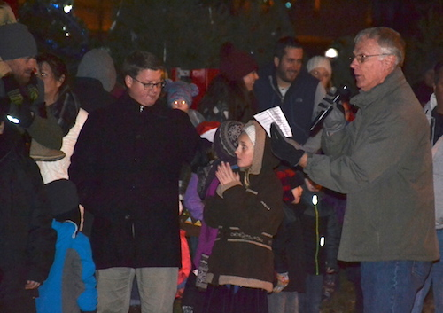 Wes Bradley, right, serves as emcee of Lyndonville's Christmas celebration in early December when Santa arrived and 61 Christmas trees were light up at Veterans' Park.