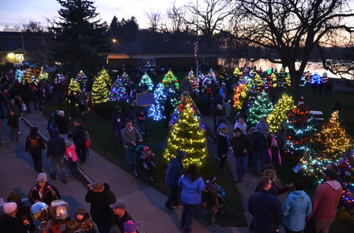 File photo by Tom Rivers: Lyndonville last year had 54 trees decorated by the community at Veterans Park. This year the celebration has grown to 61 trees. Santa will stop by the park at 5 to flip a switch, turning on the lights.