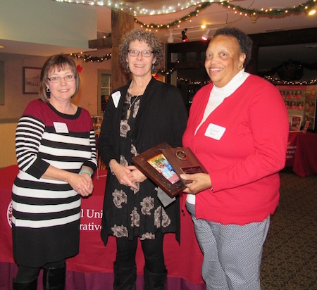 Jeannette Riley, right, received the Friend of the Master Gardeners Award. The award was presented by Master Gardener/Sr. Agriculture/Horticultural Administrative Assistant Kim Hazel, left.  Deb Roberts, interim Executive Director OCCCE, stands in the middle.