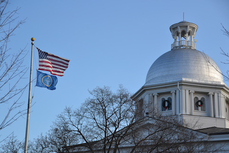 Flags flutter in the wind by the Orleans County Courthouse this morning.