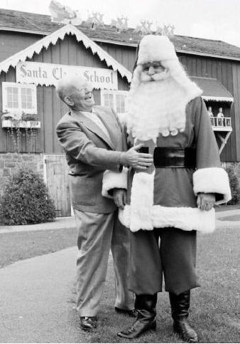 This photo shows Charles W. Howard with a Santa at Christmas Park in Albion. Howard operated the Park and a school for Santa Claus in Albion until his death on May 1, 1966.