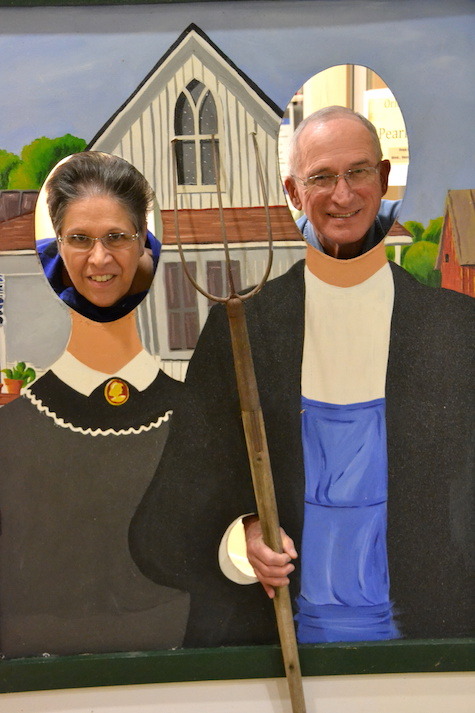 Ricci-Canham and her husband, Bud, pose in the cut-out of a farmer and his wife. The Brown family in Waterport loaned the cut-out for Sunday's book event at the library.