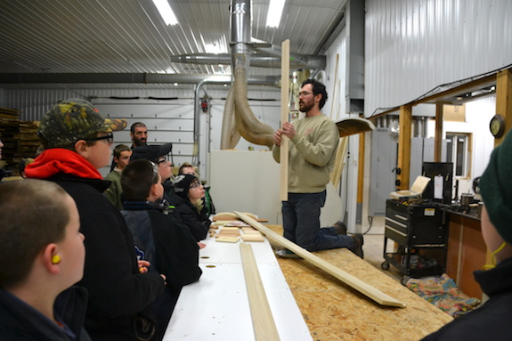 Diesel gives Scouts from Barre a demonstration on woodworking.