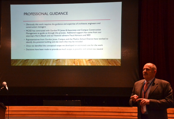 Tom Cox, Medina interim school superintendent, discusses the capital project on Tuesday evening during a public hearing in the high school auditorium. Only about a dozen people attended the forum.