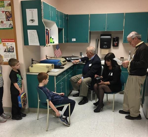 Lyndonville Lion's Club members Bruce Schmidt, left, and Lynne Johnson are joined by Jim Hancock of the Medina Lion's Club while the club organized an eye-screening event on Nov. 29 at Lyndonville.