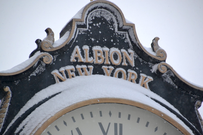 "The clock in downtown Albion is pictured this morning after the area was besieged with snow. The village was denied a state ""Main Street"" grant last week, but intends to try again next year."
