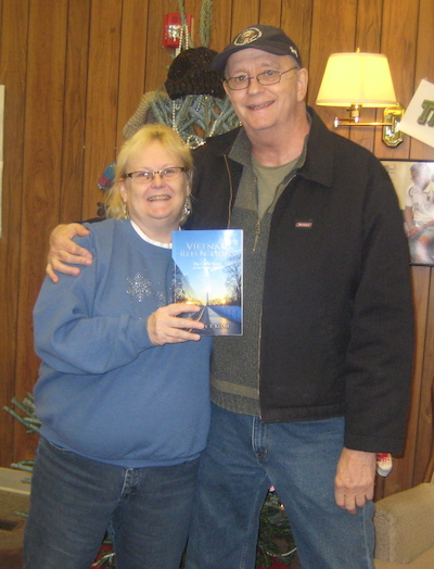 Provided photo:Don Sisson presents a copy of the book, Vietnam Reflections by Michael T. Keene, to the Community Free Library in Holley.Sandra Shaw, library director, accepts the book from Sisson, whose brother Ronnie P. Sisson was killed in Vietnam on Dec. 16, 1965.