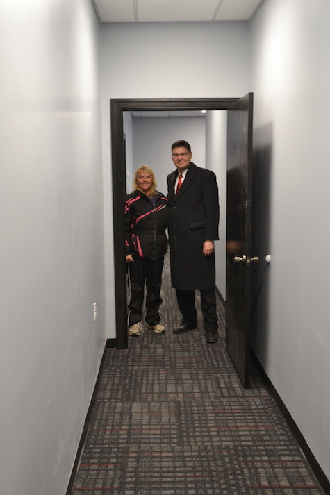 Ed Fancher, executive director of Community Action of Orleans & Genesee, and Heidi Wyant, transportation director for the agency, are pictured in a new hallway in the former bar area of the American Legion in Albion.
