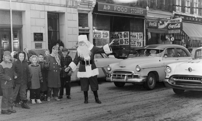 In this photo, the Santa is believed to be George Cond, who was trained as a Santa by Charles Howard and often portrayed Santa for Howard at Christmas Park in Albion. (Cond was inducted into the Santa Claus Hall of Fame in July.)