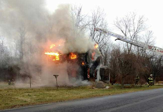 Provided photo: This photo shows the house fully engulfed by flames.
