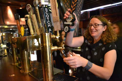 Amy Cifelli pours a glass of beer. She said the pub offers a variety of beers in a comfortable atmosphere.