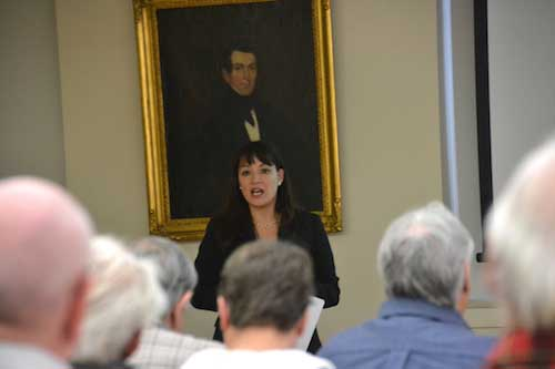 Amelia Rickard, a research assistant for the Center for Governmental Research in Rochester, is helping with the study of law enforcement services in Orleans County. She is speaking during a meeting at the Hoag Library in Albion. There was another meeting later at the Ridgeway Town Hall.