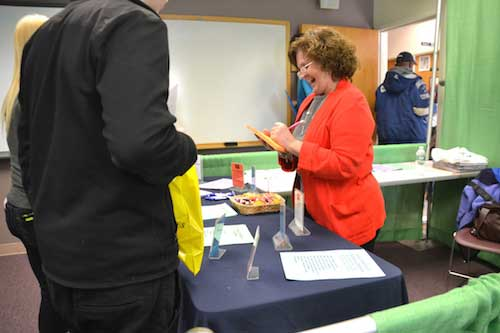 Photos by Tom Rivers: Bonnie Seelbinder, a recruiter/specialist with ATB Staffing Services, discusses job options available locally at a Job Fair on Wednesday at Genesee Community College in Albion. She touted jobs in light industrial, clerical and other entry level positions.