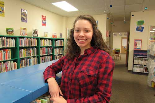 Photo by Kristina Gabalski: Grace Azzolino is the new children's librarian at the Community Free Library in Holley.