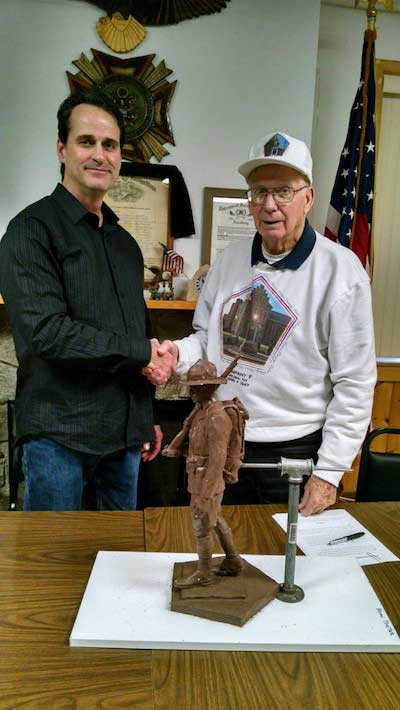 Provided photos: Artist Brian Porter is pictured with Bill Menz, chairman of the Company F Memorial Committee, after the group on Monday officially entered into an agreement to create the statue.