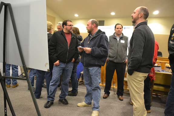 Barre residents Mark Farone, left, and Mike Van Lieshout discuss the project.