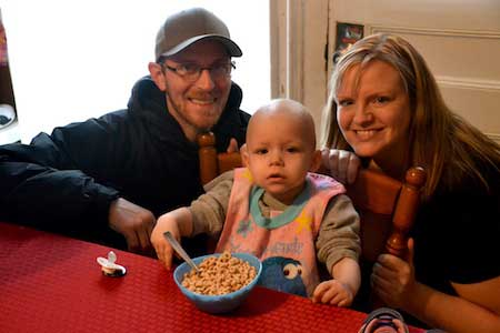 Elaina has a bowl a cereal before heading out to try the new playground. Her parents are Kyle and Beth Webb.