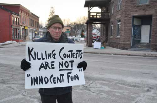 Photos by Tom Rivers: Richard Brummel is pictured in Holley last February, protesting the Squirrel Slam hunting contest.