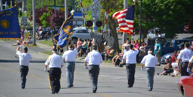 The Honor Guard marches along Main Street in Albion on Memorial Day, May 30, 2016. The Honor Guard often get the loudest applause in parades with many also saluting the veterans.