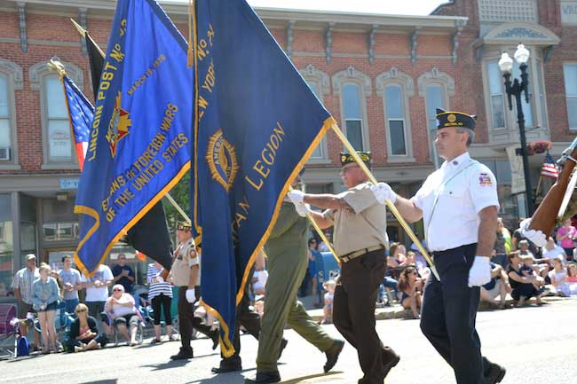 The Honor Guard, including Adam Johnson at right, marches in the Memorial Day Parade in Medina on May 30.